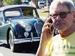 Lunch on the go! Harrison Ford brings sandwich to take a drive through Brentwood in his $150,000 Jaguar convertible
