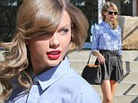 She's no schoolgirl! Taylor Swift shows off her legs in a rather short pleated skirt and blue button-down shirt