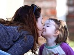 Alyson Hannigan kisses her adorable daughter Keeva as they draw pictures on the pavement together