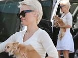 Diamond and the ruff! Newlywed Pamela Anderson looks in fine figure as she goes for a walk with her dogs barefoot