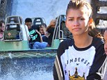 Zendaya shows no fear at Disneyland before getting soaked on rapids