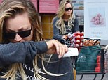 Sick Kaley Cuoco at store
