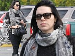 Orange is NOT the new black! Laura Prepon sticks to monochrome ensemble and leather boots on grocery store trip