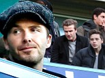 Like father, like son: David and eldest son Brooklyn Beckham attend football match looking like mirror images of each other
