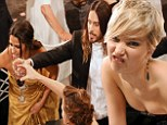 Backstage antics at the SAG Awards! Jennifer Lawrence pulls bizarre faces as Jared Leto toasts his triumphant table