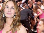 'I gave a little bit of CPR everyone's good': Julia Roberts leaps to safety as overeager fans push over barricade at SAG Awards