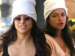 If it ain't broke! A sleepy Michelle Rodriguez recycles her favourite white beanie as she jets into Paris