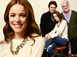 What lucky lads! Smiling Rachel McAdams snuggles up to her famous co-stars for cosy Sundance portrait