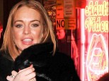 Looking for business? Lindsay Lohan dines at 'sex shop' restaurant for another wild night in London