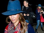 Cashing out! Jessica Alba and husband Warren wrap up as they jet out of Los Angeles