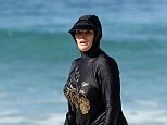 Nigella Lawson has finally explained the bizarre 'Burkini' style swimsuit choice she wore on a beach in Australia