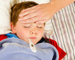 Sick child being checked for fever