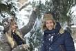 Happy couple enjoying snowfall