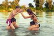 Teenage friends having fun in the river