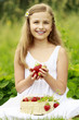 Strawberry time - young girl with picked strawberries