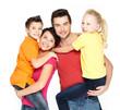 Happy family with two schoolchild children