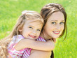 Portrait of smiling beautiful young woman and her little daughte
