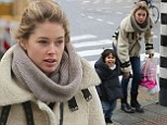 She's a model mother... in every sense of the word! Doutzen Kroes shows off her natural beauty as she goes make-up free for day out with cheeky son Phyllon