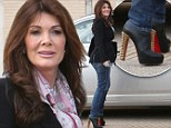 Putting her best foot forward: Lisa Vanderpump arms herself with a pair of killer Louboutins as she hits the shops ahead of stressful council meeting