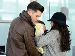 Baby's first flight: Union J's JJ Hensley and model girlfriend Caterina Lopez take son Princeton on holiday