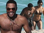 Making a splash! Singer Maxwell shows off his impressive torso in swimming shorts as he hits the beach with bikini clad girlfriend