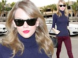 Lucky there are beds in first class! Taylor Swift hides behind dark sunglasses as she arrives at LAX for a long haul flight following her big night of dancing at the Grammys