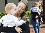 All loved up! Starry eyed Elizabeth Berkley can't take her eyes off her cute son Sky Cole during sunny LA stroll
