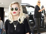 Rita Ora dashes for flight in leather biker-style trousers and trainers as she leaves LA to continue filming Fifty Shades of Grey movie