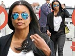 Casual style: Gabrielle Union arrived at Los Angeles International Airport on Tuesday in jeans and a T-shirt