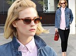 She's so '80s! January Jones is a blast from the past in pink shirt and denim jacket