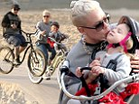 Mommy's day off! Pink showers her sweet girl Willow with kisses on family bike ride at the beach after amazing Grammys show