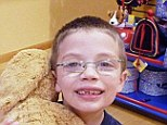 Missing: Kyron Horman cudding a teddy bear before he went missing in 2010