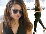 Very professional! Selena Gomez gussies up in sleek black outfit for business power meeting amid reports she's dating Austin Mahone