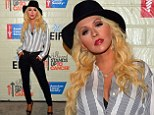 Forget The Voice...she's got the body: Christina Aguilera shows off toned, trim body in super-skinny jeans and unbuttoned shirt