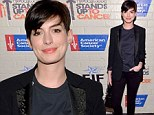 Zoebot in disguise! Anne Hathaway looks better than ever following breakup with celebrity stylist Rachel as she wears trouser suit to charity function
