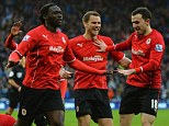 Debut strike: Kenwyne Jones (centre) celebrates scoring Cardiff City's second goal against Norwich City