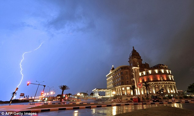 South America: A spectacular flash of lightning streaks down from the sky above Montevideo in Uruguay