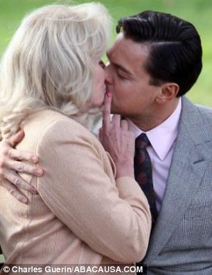 Animalistic: Joanna Lumley kisses Leonardo DiCaprio in Wolf of Wall Street