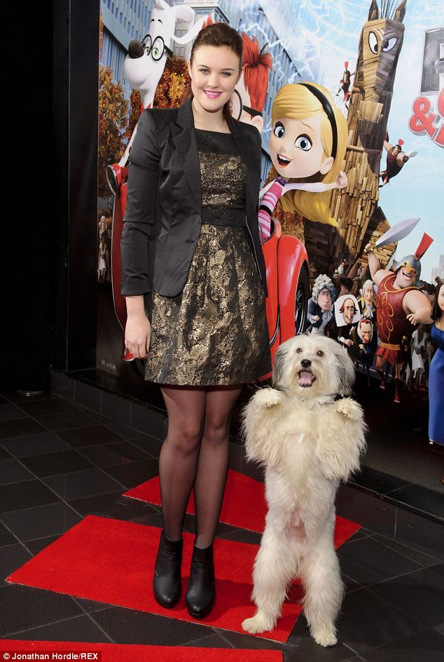 Paws up: Ashleigh poses with Pudsey, who performs a trick
