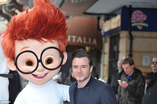 Matching hairstyles: Shane Filan poses next to a costumed Sherman from the animated cartoon