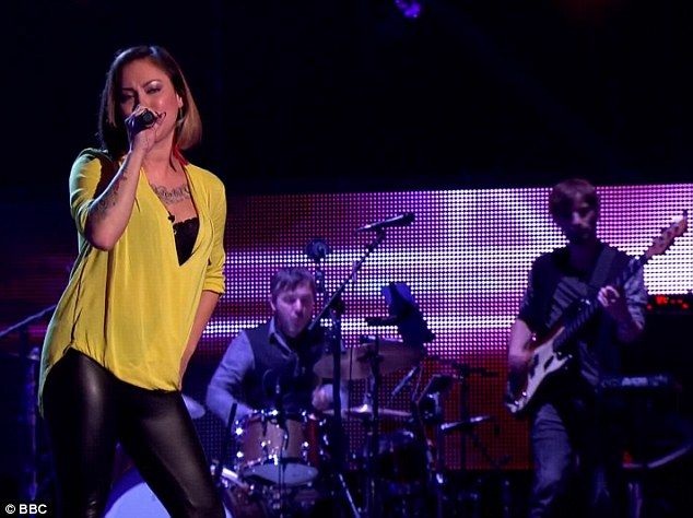 Seductive: Jai gave a confident performance in a yellow top and a pair of skintight leather trousers