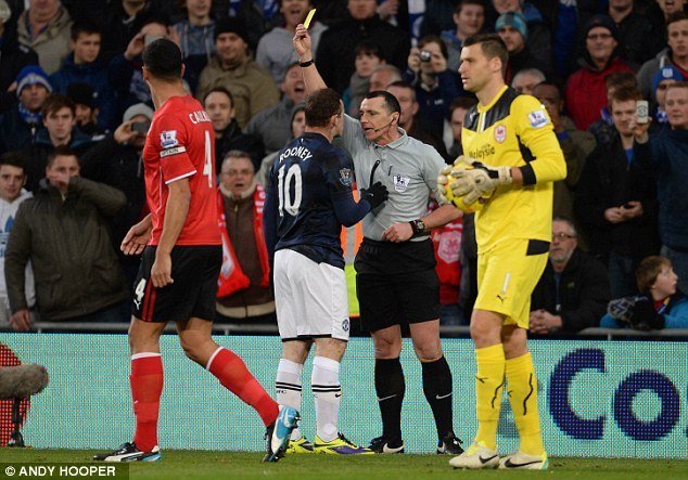Missed: Wayne Rooney receives only a yellow card after kicking out in the draw against Cardiff