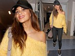 Radiant: Nicole Scherzinger is stunning at LAX airport in a lemon yellow sweater