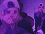 Justin Bieber flips bird at party hours after being questioned by police... as explicit photo of him with topless 'stripper' emerges