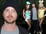 Aaron Paul looks happy to be hopping around with Playboy Bunnies at a party with his wife nowhere in sight