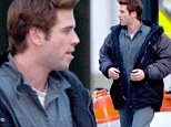 Liam Hemsworth gets back to work on Hunger Games Mockingjay in Atlanta... as ex Miley Cyrus admits they still talk