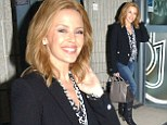 Very chic! Kylie Minogue wears a stylish black blazer for appearance in Paris