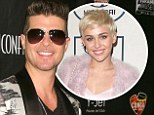 Envious? 'Robin (left) is jealous Miley's (right) career took off after that,' a source recently revealed to Us Weekly