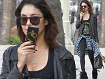 Vanessa Hudgens goes grunge as she dons a leather biker jacket and flannel tied around her waist
