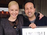 Surprise gift: Abbie Cornish posted this picture on her Instagram page, showing her receiving a framed portrait of her self from John Russo, the photographer she collaborated with on the shoot